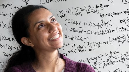 Woman looking into the distance with mathematical equations in the background